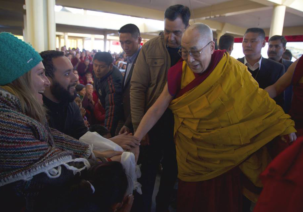 Low His Holliness Dalai lama with our Volunteer